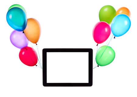 tablet computer with empty touch screen hanging on color balloons rising high Stock Photo - 25177678