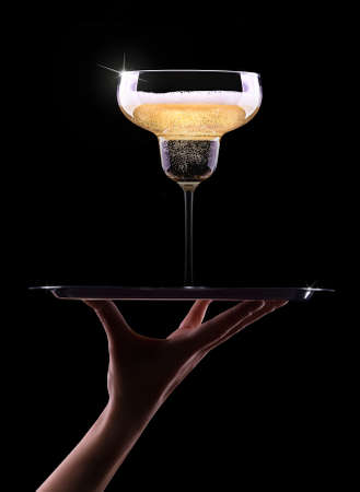 waiter hand with champagne on black background photo
