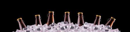 icecubes: bottles of beer on ice on black background