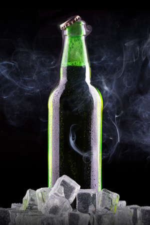 Beer bottle with ice and chill smoke photo