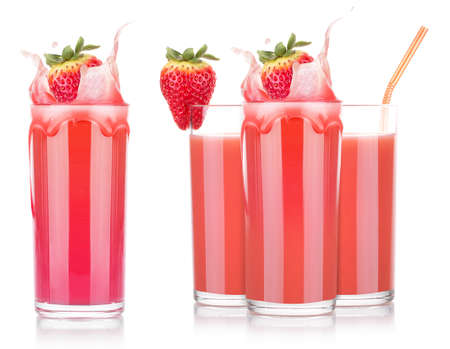 Smoothies of strawberry in glass with splash isolated on a white background photo