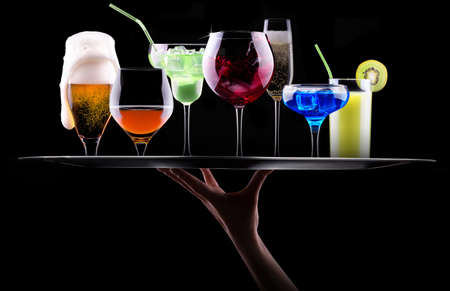 different alcohol drinks set on a tray  - beer, wine, cocktail,juice, champagne, scotch, soda photo