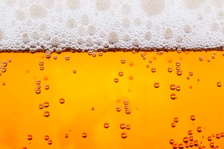 fresh beer with bubbles close up background photo