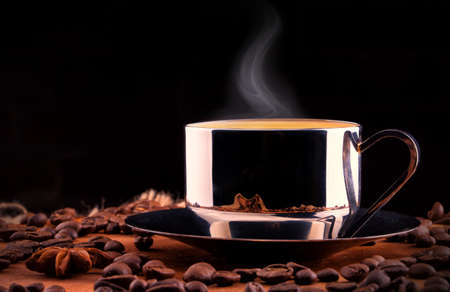 coffeetime: cup of Coffee  with coffee bean. Vintage background