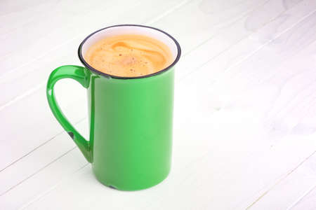 coffeetime: bright cup of Coffee on a white wooden vintage table. Grunge background Stock Photo