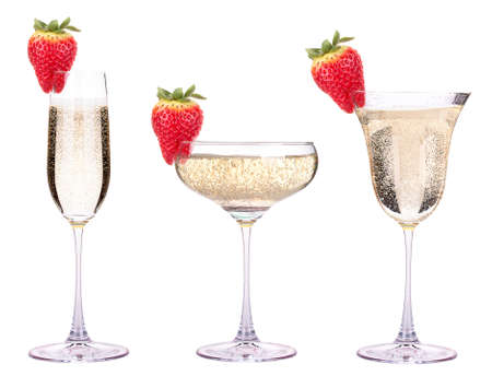 glass of champagne with tasty red strawberry isolated photo