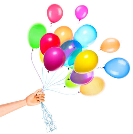 wooden hand gives flying balloons isolated. Holiday background Stock Photo