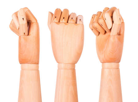 Closeup of right wooden hand - clenched fist, isolated over white background photo