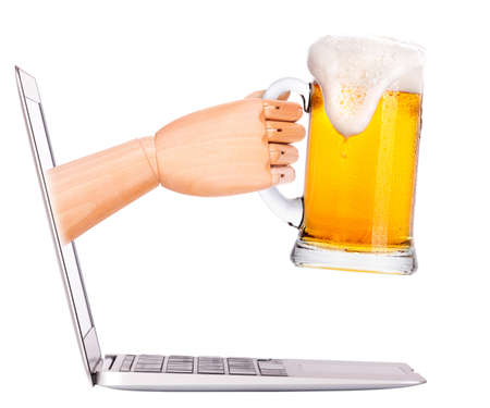 Laptop side view. beer toasting to show internet business success photo