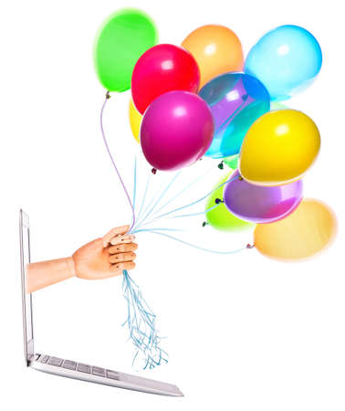 wooden hand with a balloons and laptop on a white background photo