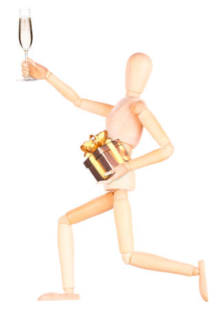 wooden Dummy with champagne holding gift Isolated Over White Background photo