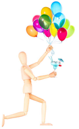 wooden Dummy with alcohol cocktail and balloons isolated Over White  photo
