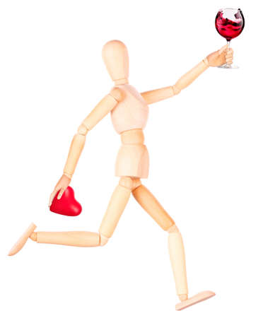 wooden Dummy with wine holding red heart Isolated Over White Background photo