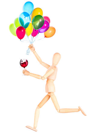 wooden Dummy with wine and balloons Isolated Over White Background photo