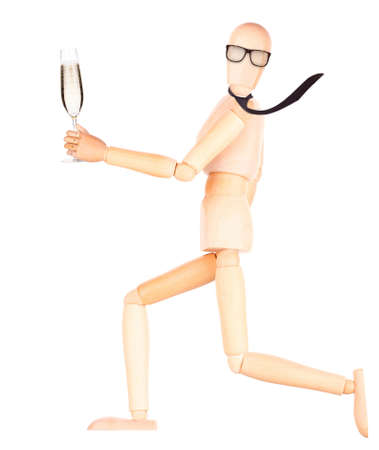 wooden Dummy with champagne making toast Isolated Over White Background photo