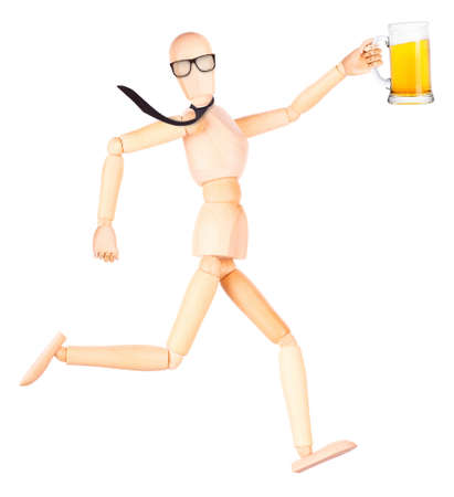 wooden Dummy with frosty glass of light beer making toast Isolated Over White Background photo
