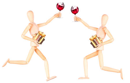 wooden Dummy with wine holding gift Isolated Over White Background photo