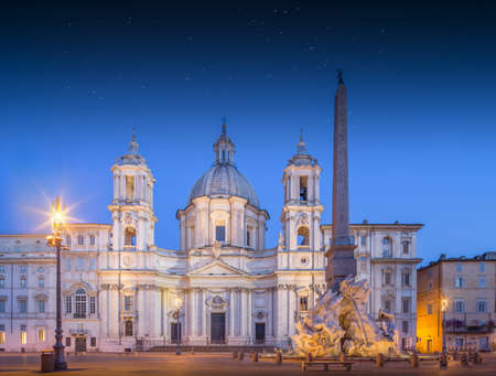 Fountain of the Four Rivers, Piazza Navona Fontana di Quattro Fiume and church SantAgnese in Agone, Rome, Italy. photo