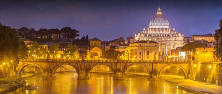 holy night: View of bridge of the Holy Angels, Ponte SantAngelo and Vatican view from Umberto Bridge after sunset, Rome, Italy Stock Photo