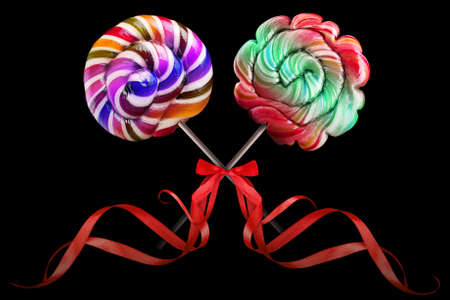 Bright colorful lollipop over black background photo