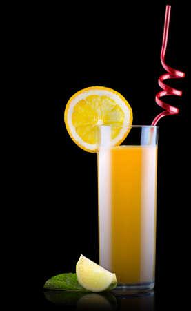 Fresh orange juice in glass with splash photo