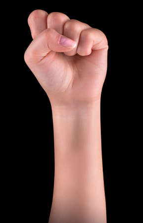 rally finger: Powerful fist pump against black background Stock Photo