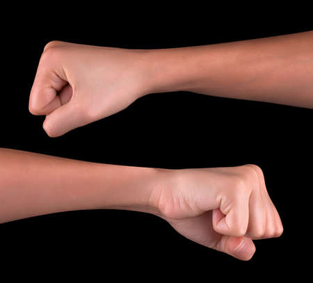 Powerful fist pump against black background Stock Photo