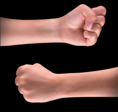 fist pump: Powerful fist pump against black background Stock Photo