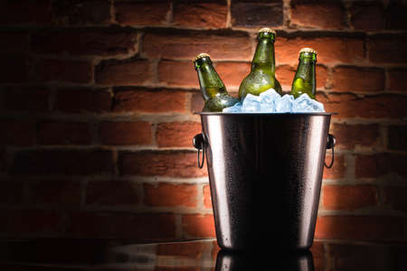 beer bucket: Beer bottles in ice bucket Stock Photo