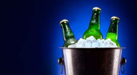 Beer bottles in ice bucket photo