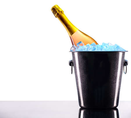 luxury bottle of champagne in Metal ice bucket with ice cubes photo