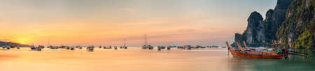 tropical beach panoramic: Beautiful image of sunset with colorful sky and Longtail boat on the sea tropical beach. Thailand