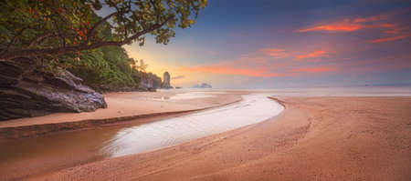 beautiful beach with colorful sky in Thailand
