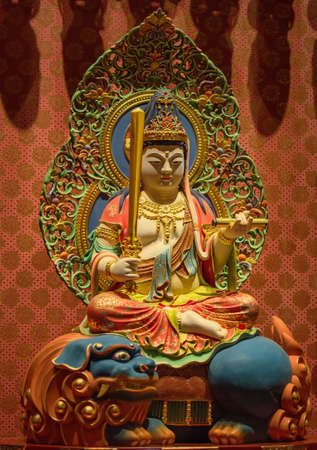 chinese buddha: The Lord Buddha in Chinese Buddha Tooth Relic Temple, Singapore Editorial
