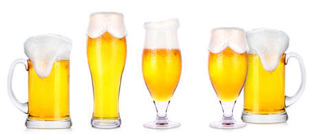 unbottled: Frosty glasses of light beer isolated on a white background