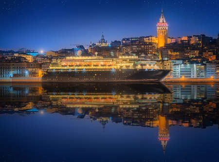Cityscape with Galata Tower, Golden Horn and ferry in Istanbul, Turkey