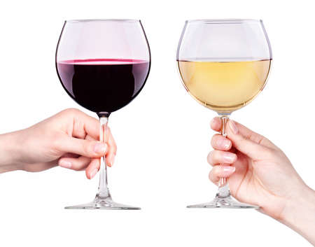 Glasses of red and white wine with splashes in hand isolated on a white background Stockfoto