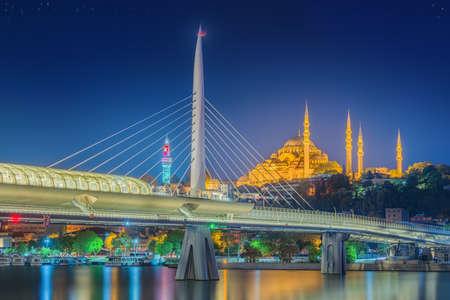 bridge: Ataturk bridge, metro bridge and golden horn at night - Istanbul, Turkey