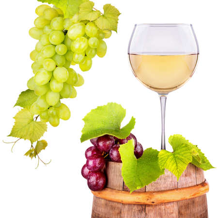 muscadet: Glass of white wine with grape  on a wooden vintage barrel on white background