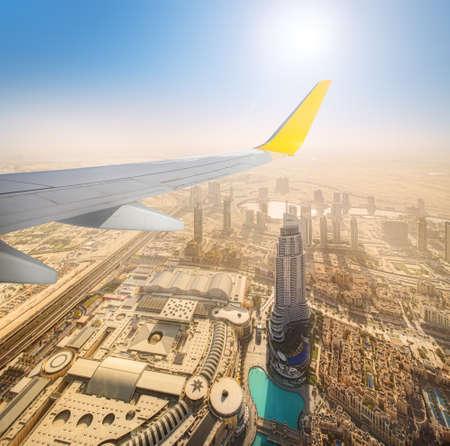 bird view: Cityscape of Dubai from aeroplane window, bird view, UAE Stock Photo