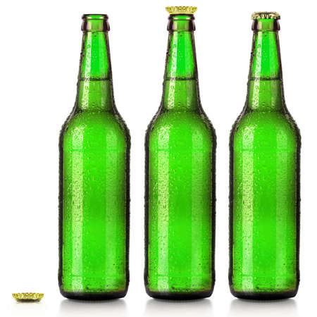 clear bottle: Set of beers bottles with frosty drops isolated on white background