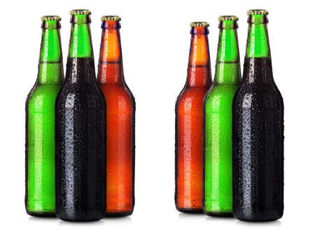 beers: Set of beers bottles with frosty drops isolated on white background