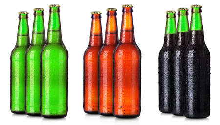 alcohol series: Set of beers bottles with frosty drops isolated on white background