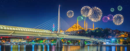 istanbul night: Ataturk bridge, metro bridge and beautiful fireworks, Istanbul, Turkey