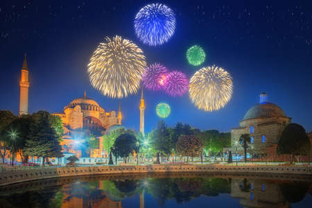 fiesta popular: Cityscape with Galata Tower, Golden Horn and ferry wirh beautiful fireworks in Istanbul, Turkey Stock Photo