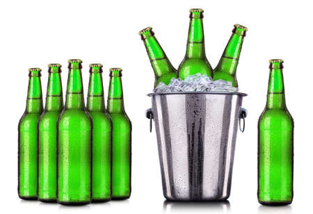 beers: Set of beers bottles with frosty drops in ice isolated on white background