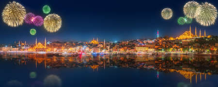 Cityscape with Galata Tower, Golden Horn and ferry wirh beautiful fireworks in Istanbul, Turkey Фото со стока