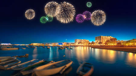 Beautiful fireworks under Ibiza island night view in San Antonio