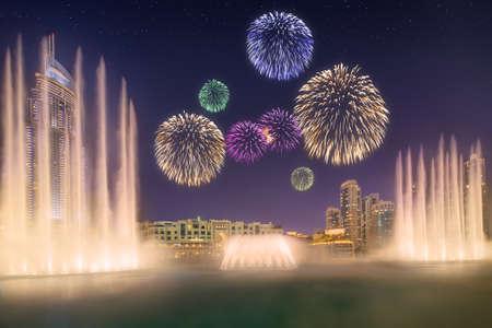 largest: Beautiful fireworks above dancing fountain in front of Burj Khalifa in Dubai, UAE
