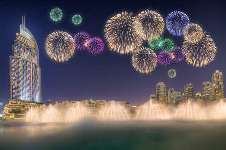 Beautiful fireworks above dancing fountain in front of Burj Khalifa in Dubai, UAE